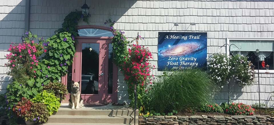 A Healing Trail Wellness Center Front Door with dog Venus - Awarded 2019 Outstanding Business Award